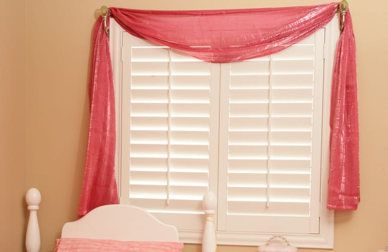 Girl's room with white shutters.